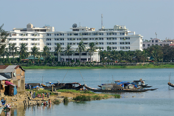 Asia, Vietnam, Hue. Poor and rich peoples housing at the banks of the Huong or Perfume River.