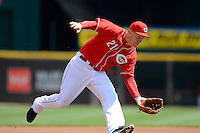 Cincinnati Reds third baseman Todd Frazier #21 fields a ball during a game against the Miami Marlins at Great American Ball Park on April 20, 2013 in Cincinnati, Ohio.  Cincinnati defeated Miami 3-2 in 13 innings.  (Mike Janes/Four Seam Images)