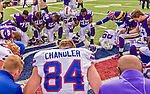 19 October 2014: Buffalo Bills and Minnesota Vikings players kneel for a brief, post-game prayer of thanks after the game at Ralph Wilson Stadium in Orchard Park, NY. The Bills defeated the Vikings 17-16 in a dramatic, last minute, comeback touchdown drive. Mandatory Credit: Ed Wolfstein Photo *** RAW (NEF) Image File Available ***