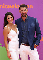 LOS ANGELES, CA July 13- Nicole Johnson, Michael Phelps, At Nickelodeon Kids' Choice Sports Awards 2017 at The Pauley Pavilion, California on July 13, 2017. Credit: Faye Sadou/MediaPunch