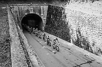 peloton exiting a tunnel<br /> <br /> Stage 13: Bourg d'Oisans &gt; Valence (169km)<br /> <br /> 105th Tour de France 2018<br /> &copy;kramon