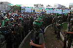 Palestinian members of the al-Qassam Brigades, the armed wing of the Hamas movement, take part in a military parade marking the first anniversary of the killing of Hamas's military commanders Mohammed Abu Shamala and Raed al-Attar, in Rafah in the southern Gaza Strip on August 21, 2015. Abu Shammala and al-Attar were killed by an Israeli air strike during the 50-day war between Israel and Hamas militants in the summer of 2014. Photo by Abed Rahim Khatib