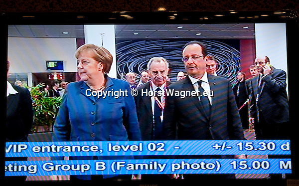 Brussels-Belgium - December 19, 2013 -- European Council, EU-summit, meeting of Heads of State / Government; here, Angela MERKEL (le), Federal Chancellor of Germany, with Francois (François) HOLLANDE (ri), President of France, captured by  EU-Council's host-broadcaster and presented on the many screens within the venue -- Photo: © HorstWagner.eu