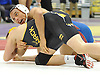 Darrell Carson of Bellport, top, battles Nick Munsch of Commack at 145 pounds during the Suffolk County Division 1 wrestling quarterfinals at Hofstra University on Friday, Feb. 12, 2016. Carson won the match by decision in overtime.