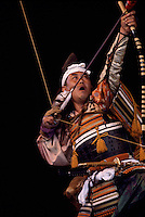 A Japanese Warrior Actor shooting Bow and Arrow in Archery Ritual Stage Performance and wearing Traditional Costume from Japan (No Model Release Available)