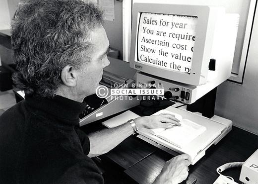 Visually impaired man using large print screen at RNIB Loughborough, UK 1990