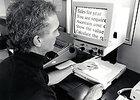Visually impaired man using large print screen at RNIB Loughborough, UK 1990