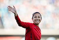 Christen Press of the USWNT waves to the crowd after being introduced before the game at EverBank Field in Jacksonville, Florida.  The USWNT defeated Scotland, 4-1.
