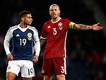 Simon Kjaer of Denmark confronts Liam Birdcutt of Scotland after his bad tackle on Erik Sviatchenko of Denmark during the Vauxhall International Challenge Match match at Hampden Park Stadium. Photo credit should read: Simon Bellis/Sportimage