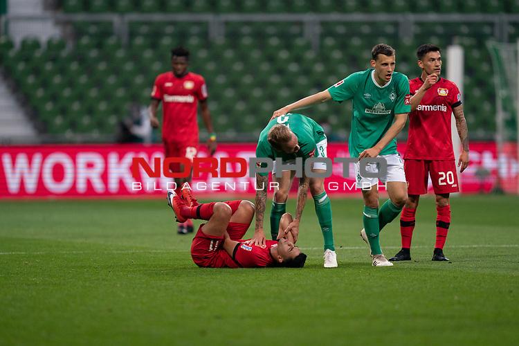 Nadiem Amiri (Leverkusen #11), <br /> Kevin Vogt (Werder Bremen  #03)<br /> Maximilian Eggestein (Werder Bremen #35)<br /> Charles Aránguiz (Leverkusen #20), <br /> <br /> Sport: Fussball: 1. Bundesliga: Saison 19/20: <br /> 26. Spieltag: SV Werder Bremen vs Bayer 04 Leverkusen, 18.05.2020<br /> <br /> Foto ©  gumzmedia / Nordphoto / Andreas Gumz / POOL <br /> <br /> Nur für journalistische Zwecke! Only for editorial use!<br />  DFL regulations prohibit any use of photographs as image sequences and/or quasi-video.