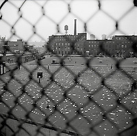 Industrial rooftop through chainlink fence<br />