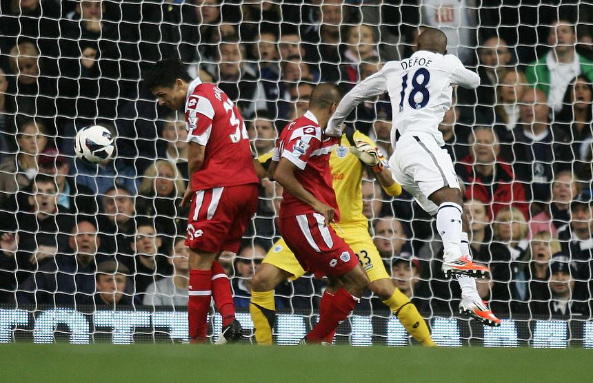 Queens Park Rangers' Alejandro Faurlin scores an own goal during todays match..Football - Barclays Premiership - Tottenham Hotspur v Queens Park Rangers - Sunday 23rd September 2012 - White Hart Lane - London..