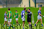 Templenoe's Adrian Spillane and ref Eamonn O'Grady in the AIB GAA Football All Ireland Junior Club Championship.