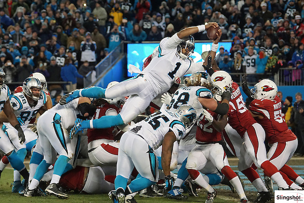 Carolina Panthers quarterback Cam Newton (2) jumps over the line and scores a touchdown during NFC Championship game against the Arizona Cardinals, Jan 24, 2016 in Charlotte, NC. (Gene Lower via AP)
