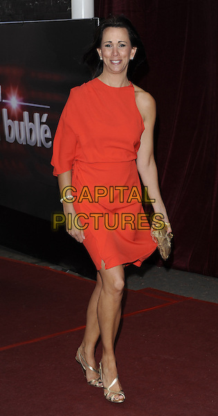 ANDREA McLEAN.'An Audience with Michael Buble' at the London ITV Studios, South Bank, London, England..May 3rd, 2010.full length red one sleeve dress gold clutch bag windy funny .CAP/CAN.©Can Nguyen/Capital Pictures.