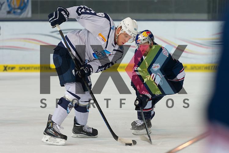 Eishockey, DEL, EHC Red Bull M&uuml;nchen - Hamburg Freezers <br /> <br /> Im Bild David WOLF (Hamburg Freezers, 89), Daniel SPARRE (EHC Red Bull M&uuml;nchen, 40) Zweikampf um den Puck beim Spiel in der DEL EHC Red Bull Muenchen - Hamburg Freezers.<br /> <br /> Foto &copy; PIX-Sportfotos *** Foto ist honorarpflichtig! *** Auf Anfrage in hoeherer Qualitaet/Aufloesung. Belegexemplar erbeten. Veroeffentlichung ausschliesslich fuer journalistisch-publizistische Zwecke. For editorial use only.