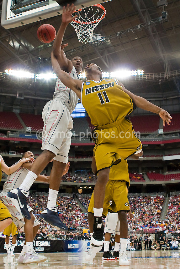Mar 28, 2009; Glendale, AZ, USA; Missouri Tigers guard Zaire Taylor (11) tries to shoot around a Connecticut Huskies defender in the first half of a game in the finals of the west region of the 2009 NCAA basketball tournament at University of Phoenix Stadium.