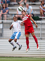 Ali Krieger (11) of the Washington Spirit goes up for a header with Maribel Dominguez (9) of the Chicago Red Stars during the game at the Maryland SoccerPlex in Boyds, Md.   Chicago defeated Washington, 2-0.