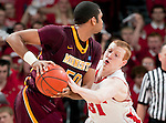 Wisconsin Badgers forward Mike Bruesewitz (31) defends against Minnesota Golden Gophers forward Ralph Sampson III (50) during a Big Ten Conference NCAA college basketball game on Tuesday, February 28, 2012 in Madison, Wisconsin. The Badgers won 52-45. (Photo by David Stluka)