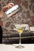 May 8, 2012. Durham, NC..  Olivia Gray, a bartender at Revolution, makes one of her signature drinks, a Pink Salt and Pepper Martini.
