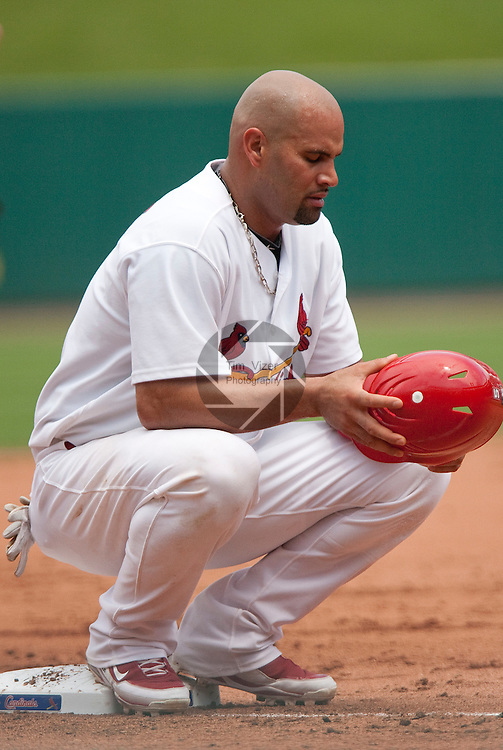 July 4, 2010          St. Louis Cardinals first baseman Albert Pujols (5) hunkers down on third base in the third inning during a break in the action.  He was one of five Cardinals players selected to play in the All-Star Game.  The St. Louis Cardinals defeated the Milwaukee Brewers 7-1 in the final game of a four-game homestand at Busch Stadium in downtown St. Louis, MO on Sunday July 4, 2010.