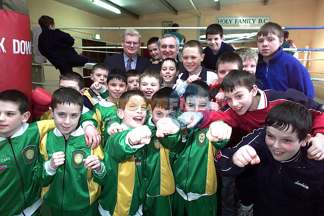 An Taoiseach, Bertie Ahern, T.D. with kids from the Holy Family Boxing Club..Picture Paul Mohan Newsfile