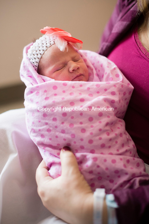WATERBURY, CT - 1 January 2016-010116EC02--    Jennifer Fay, and her husband Tom Fay, Jr., hold their first child, Aubree Lynn Fay, just hours after she was born. Waterbury Hospital welcomed the first two babies of 2016 in the city early Friday morning. Erin Covey Republican-American.