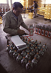 Worker boxes bottle of sake at a factory near Hachinohe, Japan. (Jim Bryant Photo).....