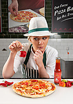A roulette-style pizza so spicy it has its own warning label will be sold in Morrisons stores ahead of Halloween.  Those daring enough to buy the Trick-or-Treat pizza risk munching on fiery chillies, 200 times spicier than Tabasco sauce, which have been secretly slipped into random slices.<br /> <br /> The hidden 'hot ghost chillies' measure more than one million units on the Scoville heat scale.  SEE OUR COPY FOR DETAILS.<br /> <br /> © Solent News & Photo Agency<br /> UK +44 (0) 2380 458800