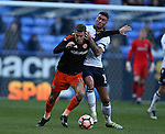 Gary Madine of Bolton tussles with Paul Coutts of Sheffield Utd during the FA Cup Second round match at the Macron Stadium, Bolton. Picture date: December 4th, 2016. Pic Simon Bellis/Sportimage