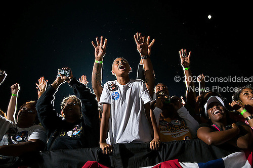 """Oct. 25, 2012.""""At a late night rally in Cleveland, supports react as President delivered his remarks."""" .Mandatory Credit: Pete Souza - White House via CNP"""