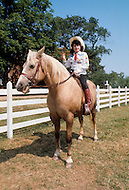 Nashville, Tennessee - June 10, 1977. This photograph was taken of Yvette Horner riding in Nashville, Tennessee, where she was playing at the Ole Opry. Yvette Horner (born September 22nd, 1922) is a renown French accordionist, whose career has spanned over 70 years, has given thousands of concerts around the world and sold over 30 million records.
