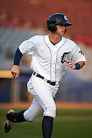 Connecticut Tigers shortstop Keaton Jones (17) runs to first during the first game of a doubleheader against the Brooklyn Cyclones on September 2, 2015 at Senator Thomas J. Dodd Memorial Stadium in Norwich, Connecticut.  Brooklyn defeated Connecticut 7-1.  (Mike Janes/Four Seam Images)
