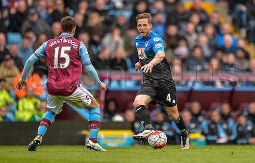 09.04.2016. Villa Park, Birmingham, England. Barclays Premier League. Aston Villa versus Bournemouth. Dan Gosling of Bournemouth passes the ball past Ashley Westwood of Aston Villa.