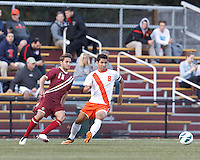 Boston College midfielder Giuliano Frano (15) and Syracuse University midfielder Nick Perea (8) at midfield. Boston College (maroon) defeated Syracuse University (white/orange), 3-2, at Newton Campus Field, on October 8, 2013.