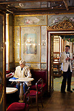 ITALY, Venice. A waiter checks on customers at Caffe Florian located in Piazza San Marco.