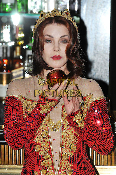 Priscilla Presley.Press launch to star in New Wimbledon Theatre's annual pantomime offering 'Snow White and the Seven Dwarfs' at The Savoy, Strand, London, England..September 26th, 2012.panto costume half length gold red dress crown sequins sequined apple  .CAP/BF.©Bob Fidgeon/Capital Pictures.
