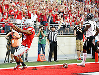 Ohio State Buckeyes wide receiver Devin Smith (9) celebrates after a touchdown after a receptions in the second quarter of the college football game between the Ohio State Buckeyes and the Cincinnati Bearcats at Ohio Stadium in Columbus, Saturday afternoon, September 27, 2014. The Ohio State Buckeyes defeated the Cincinnati Bearcats 50 - 28. (The Columbus Dispatch / Eamon Queeney)