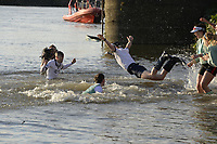 Putney/Mortlake, GREATER LONDON. United Kingdom. 2017 Women's and Men's University Boat Races, held over, The Championship Course, Putney to Mortlake on the River Thames. selection of coxes being &quot;thrown in&quot;  Sunday  02/04/2017, <br /> <br /> [Mandatory Credit; Intersport Images]