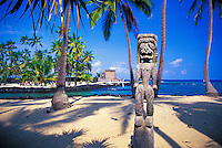 """Giant wooden carved statues stand on eternal guard at the Pu'u o Honaunau National Historic Park in South Kona on the big isle of Hawaii. It is also known as the """"""""City of Refuge"""""""" as it was used as a safe haven for vanquished soldiers and Kapu (rule) breakers."""