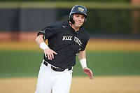 Bobby Seymour (3) of the Wake Forest Demon Deacons hustles towards third base against the Notre Dame Fighting Irish at David F. Couch Ballpark on March 10, 2019 in  Winston-Salem, North Carolina. The Fighting Irish defeated the Demon Deacons 8-7 in 10 innings in game two of a double-header. (Brian Westerholt/Four Seam Images)