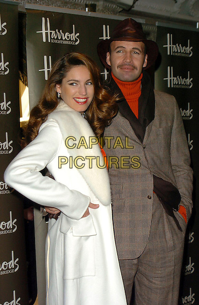 KELLY BROOK & BILLY ZANE.Harrods Winter Sale.Knightsbridge, London 28 December 2005.Ref:CAN.half length celebrity couple arm around waist white coat brown suit hat.www.capitalpictures.com.sales@capitalpictures.com.©Capital Pictures