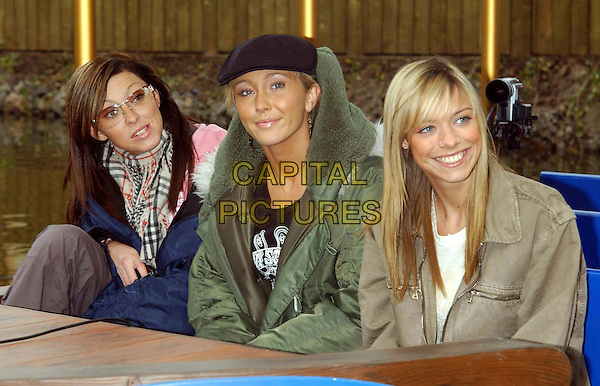 "ATOMIC KITTEN - NATASHA HAMILTON,  JENNY FROST, LIZ McCLARNON.launch new family adventure ride ""Excalibur-A Dragon's Tale"" at Drayton Manor Theme Park.April 24th, 2003.half length black hat green coat sunglasses shades  .CAP/PL.©Capital Pictures"