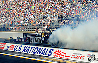 Sept. 5, 2010; Clermont, IN, USA; NHRA top fuel dragster driver Tony Schumacher does a burnout during qualifying for the U.S. Nationals at O'Reilly Raceway Park at Indianapolis. Mandatory Credit: Mark J. Rebilas-
