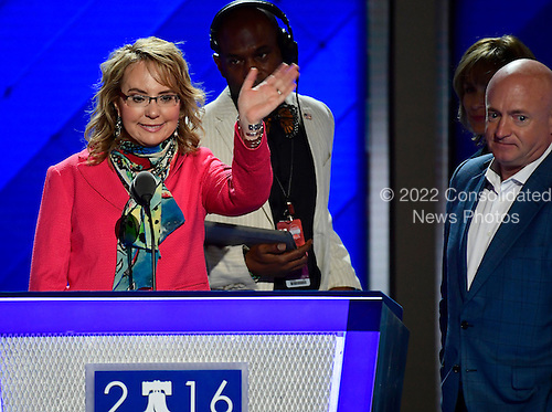 Former United States Representative Gabby Giffords (Democrat of Arizona) waves as she rehearses her remarks prior to the opening session of the 2016 Democratic National Convention at the Wells Fargo Center in Philadelphia, Pennsylvania on Monday, July 25, 2016.  Her husband former astronaut Mark Kelly look on from right.<br /> Credit: Ron Sachs / CNP<br /> (RESTRICTION: NO New York or New Jersey Newspapers or newspapers within a 75 mile radius of New York City)