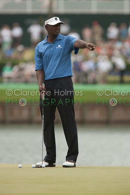 PONTE VEDRA BEACH, FL - MAY 6: Vijay Singh indicates a weekend hole location for his caddie to mark on the 17th green during his practice round on Wednesday, May 6, 2009 for the Players Championship, beginning on Thursday, at TPC Sawgrass in Ponte Vedra Beach, Florida.