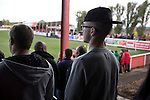 Stourbridge 4 Biggleswade Town 1, 09/11/2013. War memorial Athletic Ground, FA Cup First Round. A home supporter in a baseball cap watching the action during the first half of Stourbridge FC's match against visitors Biggleswade Town FC at the War memorial Athletic Ground in the FA Cup first round, a stadium which also doubles as a cricket ground. The match was won by the home side by four goals to one, watched by a capacity crowd of 1605. It was Biggleswade's first appearance at the first round stage of the cup, winners Stourbridge went on to play Stevenage in the second round. Photo by Colin McPherson.