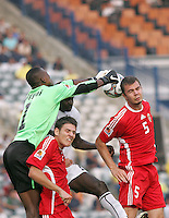 Ghana's Daniel Agyei (1) plucks the ball off of the head of Hungary's Andras Debreceni (5) to block a corner kick goal attempt during the FIFA Under 20 World Cup Semi-final match at the Cairo International Stadium in Cairo, Egypt, on October 13, 2009. Costa Rica won the match 1-2 in overtime play. Ghana won the match 3-2.