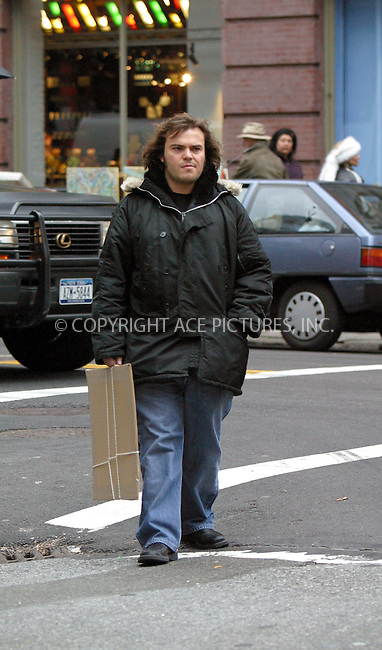 ***EXCLUSIVE***..Actor Jack Black shopping in SoHo for some pictures. Perhaps, Jask is vearing his favorite jacket or this is the only jacket he has. Everywhere he goes, he wears the same black nylon jacket. New York, December 21, 2002. Please byline: Alecsey Boldeskul/NY Photo Press.   ..*PAY-PER-USE*      ....NY Photo Press:  ..phone (646) 267-6913;   ..e-mail: info@nyphotopress.com