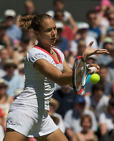 Stefanie Voegele (SUI) against Venus Williams (USA) in the first round of the ladies singles. Williams beat Voegele 6-3 6-2..Tennis - Wimbledon - Day 2 - Tues 23rd June 2009 - All England Lawn Tennis Club  - Wimbledon - London - United Kingdom..Frey Images, Barry House, 20-22 Worple Road, London, SW19 4DH.Tel - +44 20 8947 0100.Cell - +44 7843 383 012